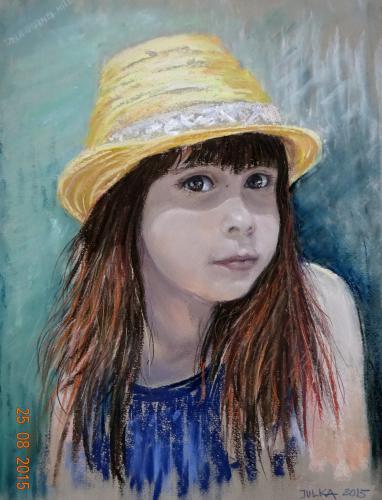 Dziewczynka w słomkowym kapeluszu